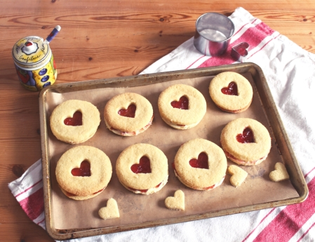Souvaroff biscuits filled with cream and jam with a heart decoration. Posh jammie dodgers