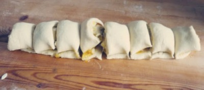 Chelsea buns - cutting the filled dough into coils