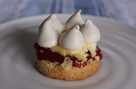 Crowned cream tea - a rich scone with jam, Cornish clotted cream and a mini meringue crown