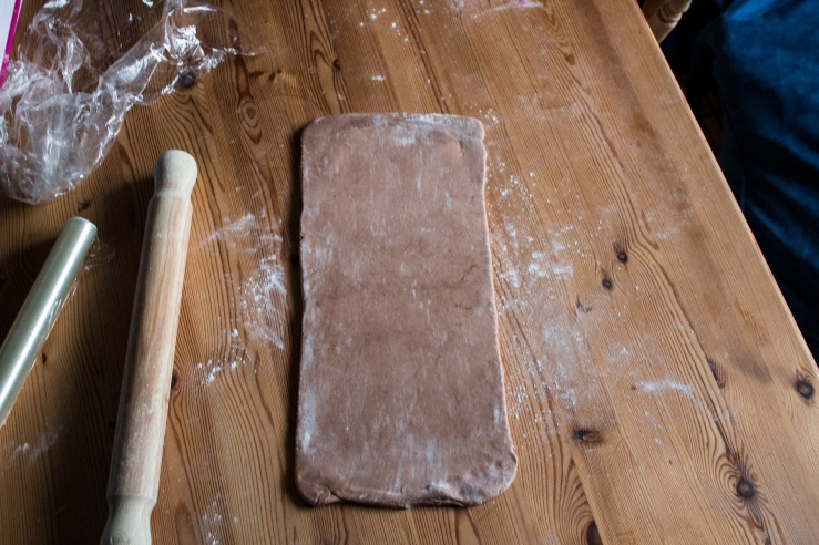 Chocolate puff pastry dough rolled before folding