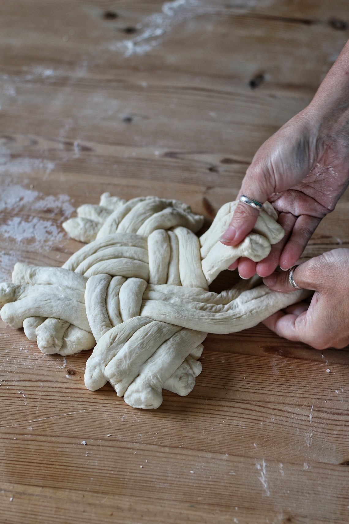 The stages of braiding a ball plait loaf by Ink Sugar Spice