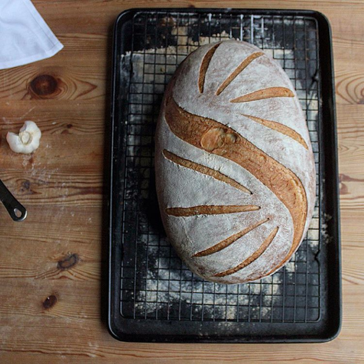 I used a simple perpendicular light slash for the 'rays' and an angled slash to create the large, open wave in the centre - an example of changing the angle of the blade to achieve different effects - you may notice I accidentally popped an air pocket with the large slash, luckily it was quite a small one and didn't affect the rise of the loaf (a large air pocket that is popped is likely to deflate the loaf!)
