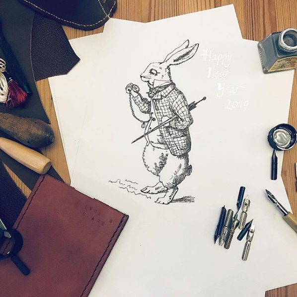 Happy New Year! The white rabbit checks if it's midnight yet - ink Sugar Spice illustration