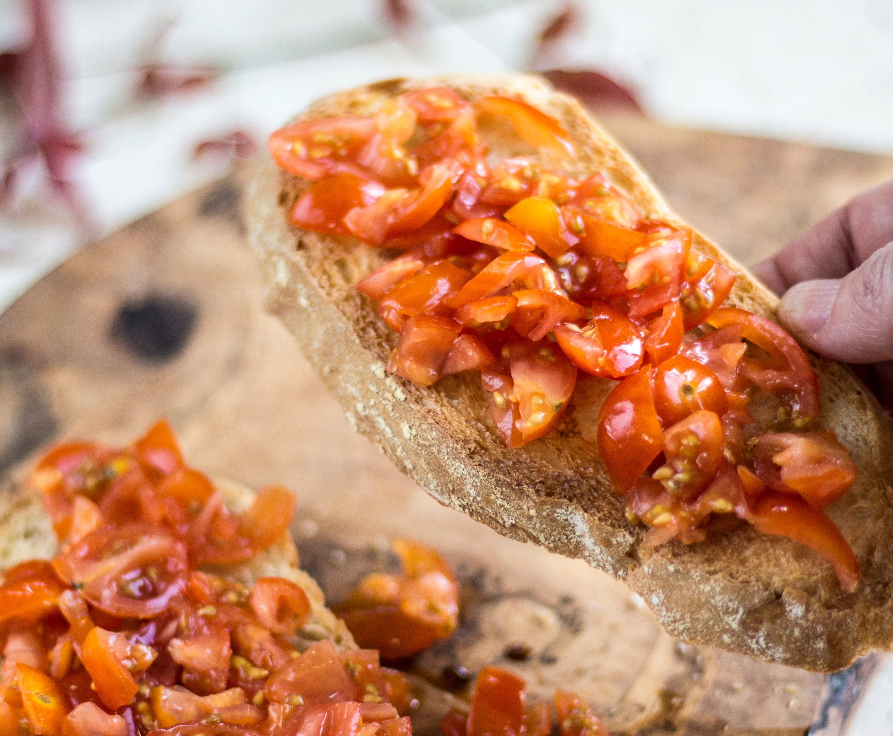 Image of bruschetta, in this case tomatoes on toasted sourdough
